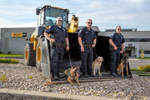 Left to right - Officer Isaiah Wear with K9 Odin, Officer Tyler Marston with K9 Dory and Officer Rick Lee with K9 Randy.