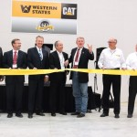 """Idaho Governor C.L. """"Butch"""" Otter (hand raised) and CEO Tom Terteling (fourth from left) get set to cut the ribbon."""