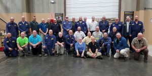 "Julie and the graduates of the ""WSECO Missoula Barber College"" sporting their new hairstyles."