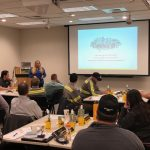 Krissy Schilz, HR Generalist, leads a group discussion on teamwork and collaboration.